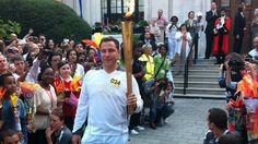 Comedian David Walliams takes the torch in Islington, London.