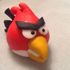 Angry Birds by Elaine Hayes Brown on Facebook completely edible made out of fondant, no gumpaste. Cake decoration or cupcake decor.