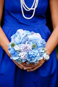 bright blue bridesmaid dress with light blue bouquet - preppy New York Sagamore resort wedding photo by New York wedding photographer Tracey Buyce