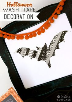 Use washi tape to make a simple Halloween decoration! Great kids project! #halloween #washi www.sisterssuitcaseblog.com