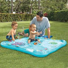 """$23! """"Babies love cooling off in our gentle tide pool, with extra-soft sprayers to splash in and explore. As baby becomes more comfortable in the water, you can make the """"fountains"""" higher (just turn up the pressure of your garden hose). There's even a pat mat area with floating 3D fish. With fun undersea graphics (tickle a turtle; cover the whales' blow hole!). For ages 12 months and up."""" $22.95"""