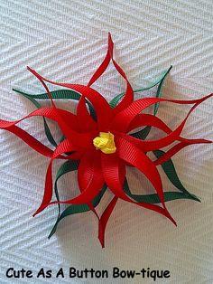 Poinsettia Ribbon Sculptured Hair Bow. $6.25, via Etsy.