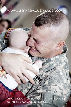 The photographer is the talented lissarrague images. She took this picture for Operation Love ReUnited (OpLove), an organization that puts together soldiers deploying or returning with volunteer photographers. In the picture shown this daddy is seeing his daughter for the first time. God bless all of those serving in the military...