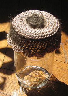 fitted glass cover  Bocal en laine by espercoquette, via Flickr