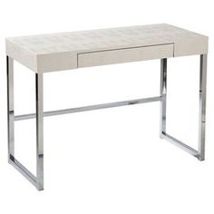 """Bring harmony to your workspace or office with this contemporary 1-drawer desk, showcasing a faux croc texture and cream finish.  Product: Writing deskConstruction Material: Engineered wood and plasticColor: White and silverFeatures:  One drawerFaux croc textureDimensions: 30"""" H x 42.25"""" W x 19.25"""" D"""