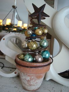 Ornament Tree made from reposed items old bed spring old vintage clay pot and some vintage Christmas bulbs