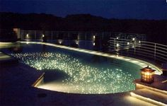 A pool with stars in the bottom! How cool.  Wish I had seen this when we put our pool in.