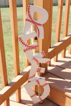 (Baseball painted letters screwed to a bat; another cute idea for a lil boys room.)
