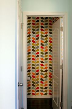 Love this wall paper for a guest bathroom, or a closet...
