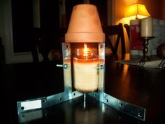Heat Your Room with 1 Candle plus Flowerpots, Nuts and Washers