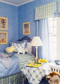 Blue-Ribbon Design - A wide tailored valance over the windows shows off a large-scale plaid fabric selected to coordinate with the duvet fabric. The pretty fabric-laced bow detail ties in with the duvet, pillow border, and draperies. Neat blue bows decorate the tablecloth and pillow sham. Discover more kids room decorating and organizing tips and ideas @ http://kidsroomdecorating.net