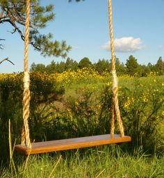 Etsy shop: SkySaddleSwings  This handmade swing is made from a fine piece of solid Red Oak and is built to truly endure the test of time. The perfect compliment to any garden, yard, or play area.  http://www.etsy.com/listing/88356221/wooden-rope-tree-swing-with-15-of-rope#