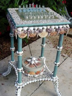 Beach Decor Seaside Fantasy Shelled Chess by PinkPelicanDesigns, $525.00, although I would prefer the surrounding top of the board to be smooth, so as not to snag a sweater,etc.
