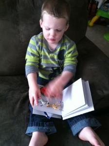 Teaching a deaf blind boy to read.