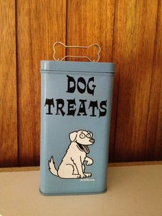 DIY Dog Treat Tin. Spray Paint an old tin, add vinyl stickers and a bone shaped cookie cutter for a handle.