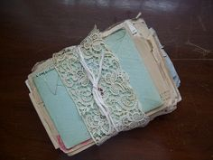 So simple, so elegant, so romantic. Old letters or cards wrapped in lace. I would do this just for decoration.