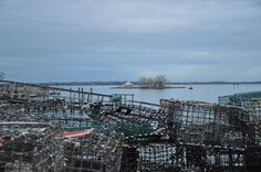 lobster traps at Noank, CT harbor with Mouse Island in the background.  photo by Diana Gray