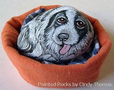 Painted rock happy to be brought to life as a puppy.