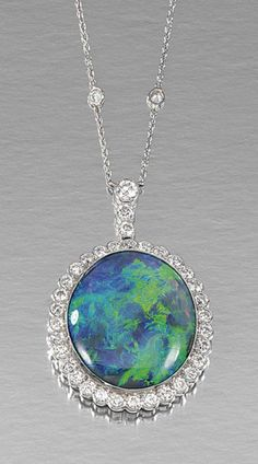 OPAL PENDANT NECKLACE centring on an oval opal, to a surmount and within a surround millegrain-set with brilliant-cut diamonds, to a trace link chain spectacle-set at intervals with brilliant-cut diamonds