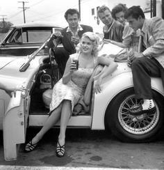 Jayne Mansfield with a bevy of admirers, 1950s