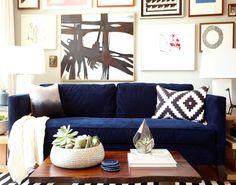 navy sofa + art wall