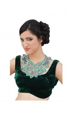 Jewelled neckpiece Sleeveless Green Velvet FABRIC CARE saree blouse patterns. Embellished with stone and Swarovski elements in peacock motifs. For more detail visit http://www.kbshonline.com/