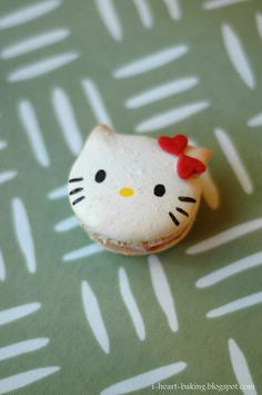 hello kitty macarons filled with strawberry-lemon cream cheese frosting