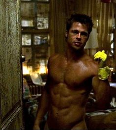 brad pitt. I remember this shot. How could I forget...... playin with the belly button .