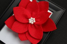 """Red Felt Poinsettia -Christmas Red Flower with pearls. """"Noelle Collection"""". $9.95, via Etsy."""