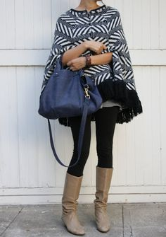 A fringe knit poncho is a unique addition to your fall ensemble, and warm too!