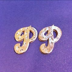 Initial post earrings. Available in 10-carat gold or 14-carat gold at goldennames.pro. #jewelry