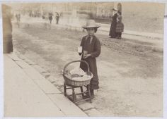 "1884 photo captioned ""Photograph of a little girl standing by a basket on a stool with a jar of shrimps and paper bag in her hand."" The National Archives catalogue reference: COPY 1/369/257"