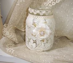 Mason jar with lace.    http://www.weddingthingz.com/1/post/2012/11/mason-jar-decor.html
