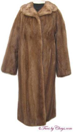 SOLD! Mahogany Mink Fur Coat #MM636; Excellent Condition; Size range: 6 - 10. This is a lovely genuine natural light mahogany mink fur coat. It has a Roland Forgues label and features a notched collar and two exterior pockets as well as one pocket hidden in the lining. The lining is solid dark golden taupe. It closes with furrier's locking clasps, and there is one hook and eye at the collar. This gorgeous mahogany mink coat will keep you cozy as well as well-dressed at the same time!