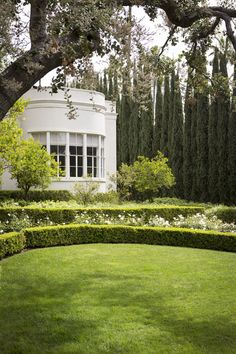 May 2013 Issue - Boxwood hedges and cypress trees outside a white home
