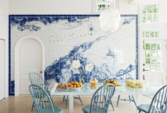A custom-made blue-and-white tile map of Shelter Island, New York, dominates the breakfast area of a home on the island.