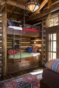 Colorful blankets in this Montana log home bunkroom