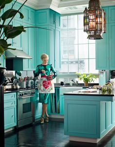 Turquoise kitchen. D sequined dress. Apron. Chandelier.