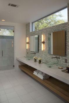 bathroom with window above sinks