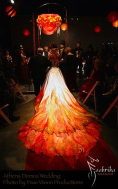 Beautiful fire inspired wedding gown train shared by lion more