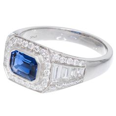 Art Deco Natural Sapphire Platinum Ring. Beautiful Handmade Art Deco 1920-1930 ring. All handmade in Platinum. Excellent condition with 8 custom cut graduate baguette diamonds and beautiful round full cut diamonds. Filigree sides. The center is set with a gem color bright vibrant slightly purplish blue emerald cut sapphire