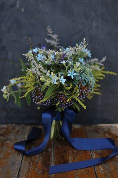 Green and blue bridal bouquet #wedding #flowers