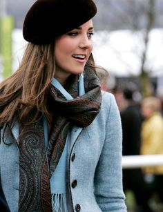 Love the color combination of her light blue jacket with the brown paisley scarf. Thinking of fall...