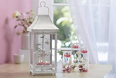 Changing Seasons Lantern is a traditional shape with a clever update – heat from tealights spin the removable metal insert. Display the swirling snowflakes insert for winter and the soaring birds for other seasons. Or, remove the insert and use lantern with a pillar candle. Metal with an antiqued finish. Shown with Symmetry Trio; all candles and accessories sold separately.