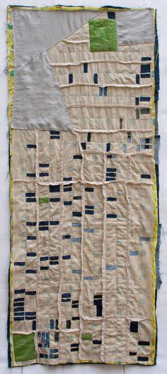 "kathryn clark foreclosure quilts - Cleveland  ""A map of the Forest Hills neighborhood in Cleveland, OH. The navy rectangles represent foreclosed or abandoned lots. The green applique patches show where community gardens have been planted on top of empty lots. The patterned fabric is called ""Forest Hills"" and features bucolic scenes of suburbia with quaint houses and frolicing deer."""