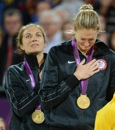 United States gold medalists Misty May-Treanor and Kerri Walsh become emotional in the women's beach volleyball medal ceremony
