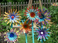Aluminum Can Flowers: cut tops off cans, cut slits, fold slits out to form petals, repeat and stack and decorate!