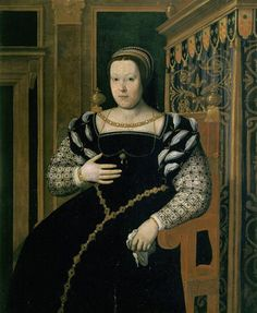 Catherine de Medicis, reine de France by Santi di Tito                      This is a lower quality portrait of Catherine de Medici wearin a black and white dress.    The rolled portions of her sleeves are slashed. She wears a necklace attached to the sides of her neckline and another connected to a brooch on her bodice using graceful swags on each side of the brooch, something ladies wore up to World War I.