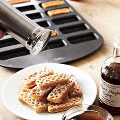 Wilton Waffle Dipper Pan at Sur La Table. Looks like a great way to make waffles for a crowd.