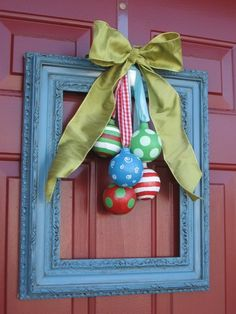 Christmas door decor. Not sure how i feel about the frame, but i like the ornaments x
